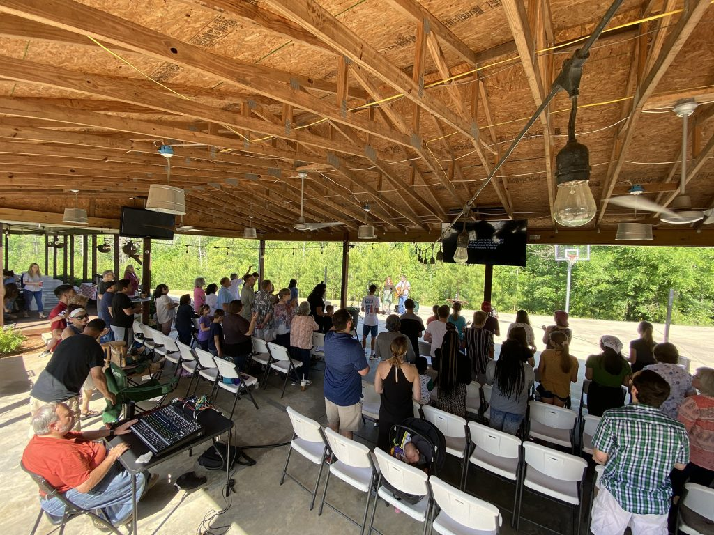 Calvary Chapel Riverbend is meeting outdoors at the Kayser Farm in Iron Station, NC